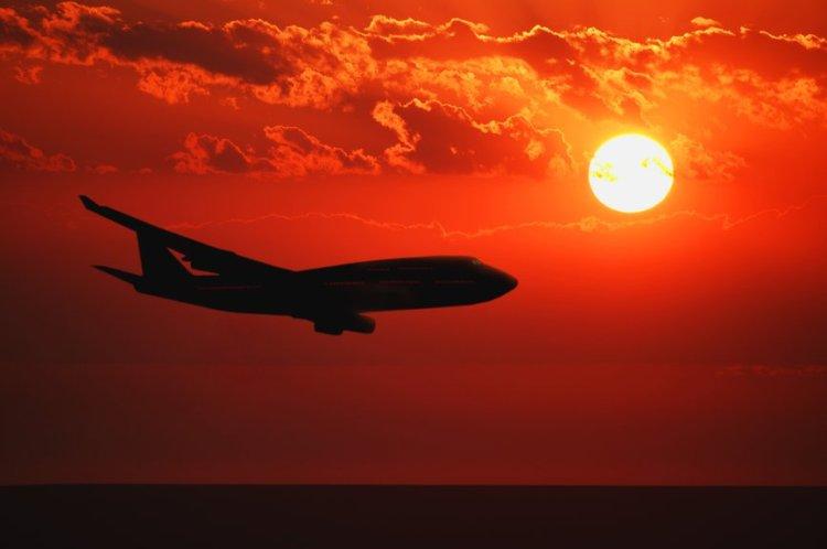 plane-flying-sunset-the-allrounder